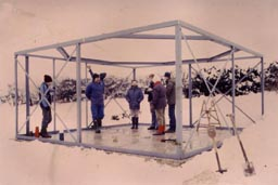 A work party inspects the observatory frame in winter